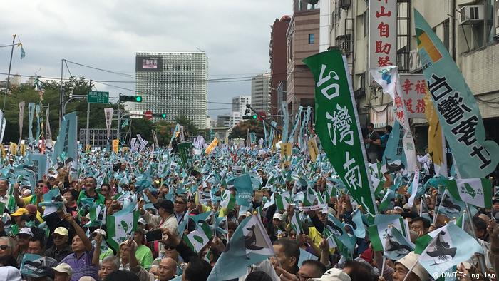 Demonstrators hold signs during a pro-independence rally in Taiwan