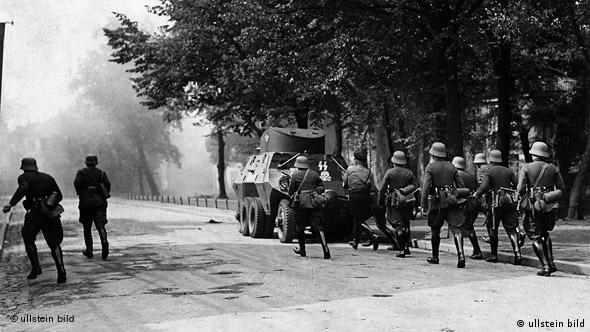 Nazi troops lead an attack on the Danzig post office