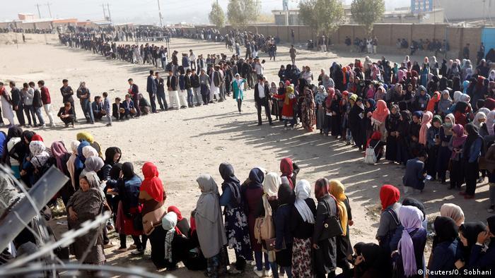 Afghan voters wait in long lines to vote