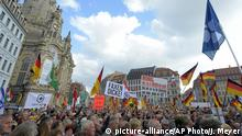 People take part ib a rally of PEGIDA (Patriotic Europeans against the Islamization of the West) in Dresden, Germany, Sunday, Oct.21, 2018. (AP Photo/Jens Meyer)  