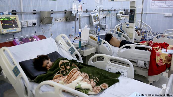 Children lie in their hospital beds