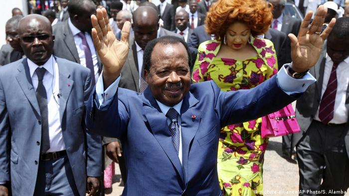 Cameroonian President Paul Biya waves to supporters