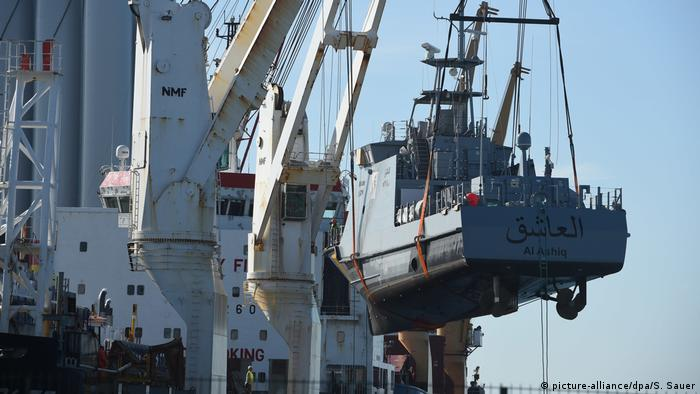 A patrol boat being loaded onto a ship