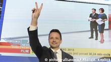 Warsaw city mayor candidate from the main opposition party Civic Platform, Rafal Trzaskowski reacts as first exit polls indicating him as the winner are announced in Warsaw, Poland, Sunday, Oct. 21, 2018. Poland's ruling conservative Law and Justice party, whose policies have drawn massive street protests and repeated clashes with its European Union partners, faces a major test of support in Sunday's local elections, the first in a string of votes that can strengthen or chip its firm grip on power. (AP Photo/Alik Keplicz)  