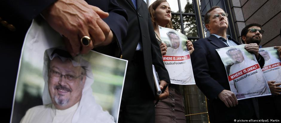 Protesters hold posters of murdered journalist Jamal Khashoggi