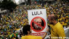 Supporters of Jair Bolsonaro, far-right lawmaker and presidential candidate of the Social Liberal Party (PSL), hold a sign with the image of former Brazilian president Luiz Inacio Lula da Silva reading Lula, never again during a demonstration in Sao Paulo, Brazil, October 21, 2018. REUTERS/Nacho Doce