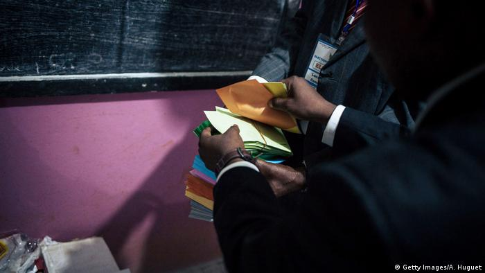 Officials count votes in the Cameroon election