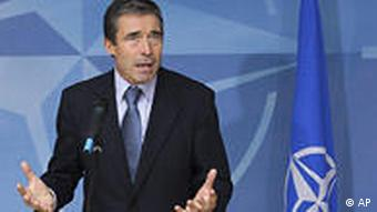 NATO Secretary General Anders Fogh Rasmussen addresses the media at NATO headquarters in Brussels, Tuesday Aug. 25, 2009.