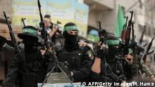 Members of the Islamist movement Hamas' military wing Al-Qassam Brigades ride in vehicles