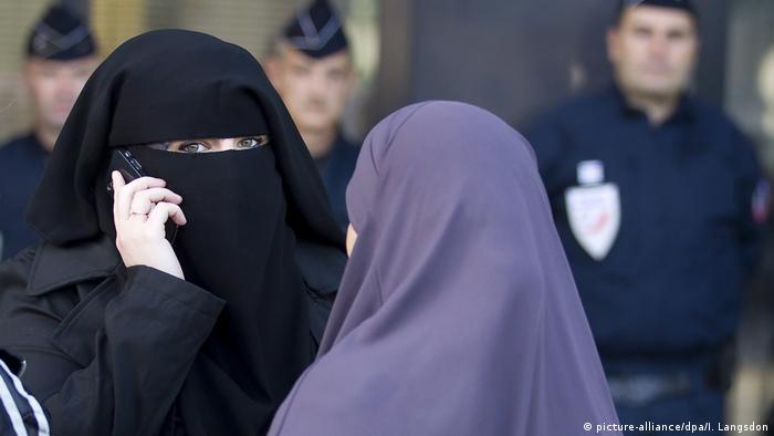 Two women wearing niqabs