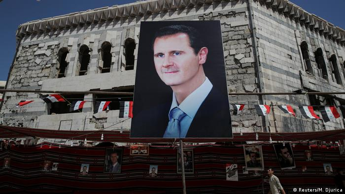 A giant billboard showing President Bashar al-Assad in Douma, outside Damascus (Reuters/M. Djurica)