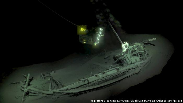 A ship wrecked at the bottom of the ocean.