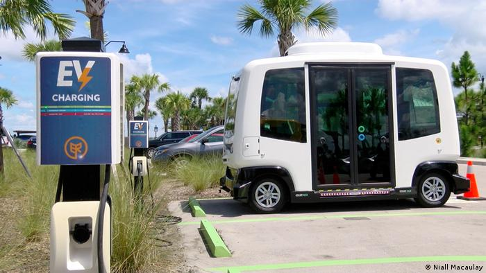 Self-driving bus at a green energy charging station
