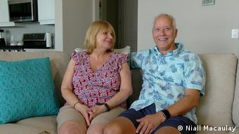 Richard and Robin Kinley sitting on a sofa in their home at Babcock Ranch
