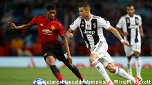 Manchester United v Juventus - UEFA Champions League - Group H - Old Trafford. Manchester United's Marcus Rashford (left) and Juventus' Cristiano Ronaldo during the UEFA Champions League match at Old Trafford, Manchester. Picture date: Tuesday October 23, 2018. See PA story SOCCER Man Utd. Photo credit should read: Martin Rickett/PA Wire URN:39288403 |