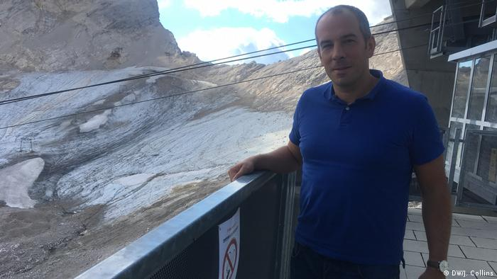 Scientist Michael Krautblatter stands in front of what's left of the Zugspitze glacier