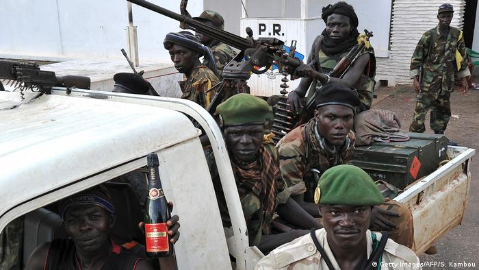 Seleka rebels on a pick-up truck mounted with a machine gun