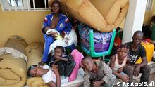 Congolese migrants who crossed the border with Angola camp with their belongings outside the General Directorate of Migration (DGM) border agency headquarters at the Kamako border, Kasai province in the Democratic Republic of the Congo, October 13, 2018. Picture taken October 13, 2018. REUTERS/Giulia Paravicini