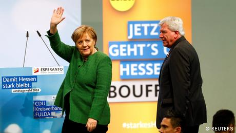 Hesse State Premier Volker Bouffier and German Chancellor Angela Merkel at a 2018 campaign rally (REUTERS)