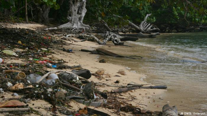 Trash is strewn across a beach in Honduras