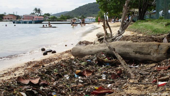 Trash covers a beach in Honduras