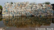 Plastic waste piled outside an illegal recycling factory in Jenjarom, Kuala Langat, Malaysia October 14, 2018. Picture taken October 14, 2018. REUTERS/Lai Seng Sin TPX IMAGES OF THE DAY