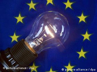 A lit light bulb in the center of the stars of the European flag