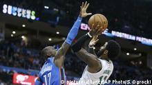 Boston Celtics guard Kyrie Irving (11) shoots as Oklahoma City Thunder guard Dennis Schroder (17) defends in the second half of an NBA basketball game in Oklahoma City, Thursday, Oct. 25, 2018. (AP Photo/Sue Ogrocki)  