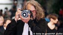 Frankreich Cannes - Wim Wenders mit Kamera (Getty Images/AFP/F. Guillot)