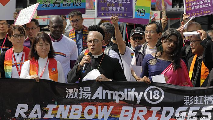 Members of a pro-gay Christian group assemble before the start of a gay pride parade in Taipei