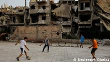 Children play soccer in al-Khalidiya area, in the government-controlled part of Homs, Syria, September 18, 2018. In the al-Khalidiya district of Homs, retaken by the government in 2013, after heavy army bombardment and air strikes, the slow nature of recovery is clear....REUTERS/Marko Djurica