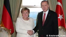 Turkish President Tayyip Erdogan shakes hands with German Chancellor Angela Merkel in Istanbul, Turkey October 27, 2018. Kayhan Ozer/Pool via REUTERS