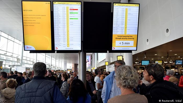 Passengers wait during the strike by baggage handlers at Brussels airport