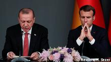 أردوغان وماكرون في صورة من الأرشيف