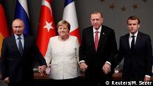German Chancellor Angela Merkel, Russian President Vladimir Putin, Turkish President Tayyip Erdogan and French President Emmanuel Macron attend a news conference after a Syria summit, in Istanbul, Turkey October 27, 2018. REUTERS/Murad Sezer