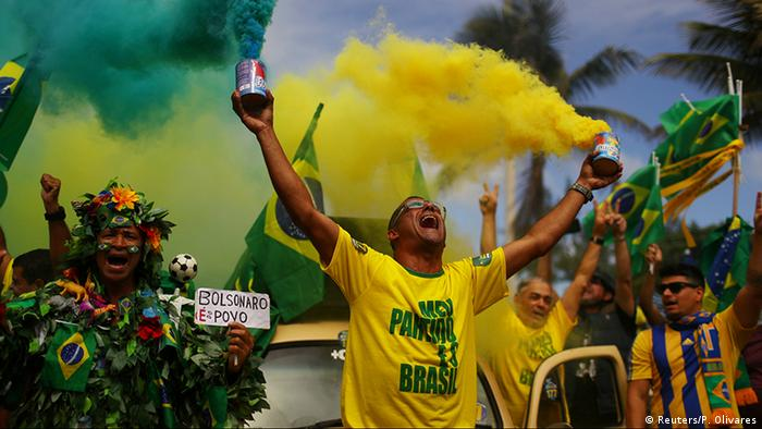 Bolsonaro supporter celebrates (Reuters/P. Olivares)