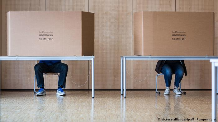 Voters at a polling station in Hesse