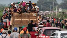 TOPSHOT - Honduran migrants taking part in a caravan heading to the US, leave Arriaga on their way to San Pedro Tapanatepec, southern Mexico on October 27, 2018. - Mexico on Friday announced it will offer Central American migrants medical care, education for their children