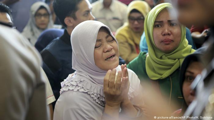 Relatives of passengers on board a Lion Air flight that crashed off Java Island in Indonesia wait for news of survivors