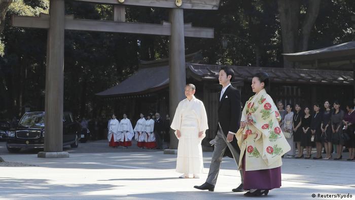 Princess Ayako and Kei Moriya head to their wedding ceremony at Meiji Shrine in Tokyo