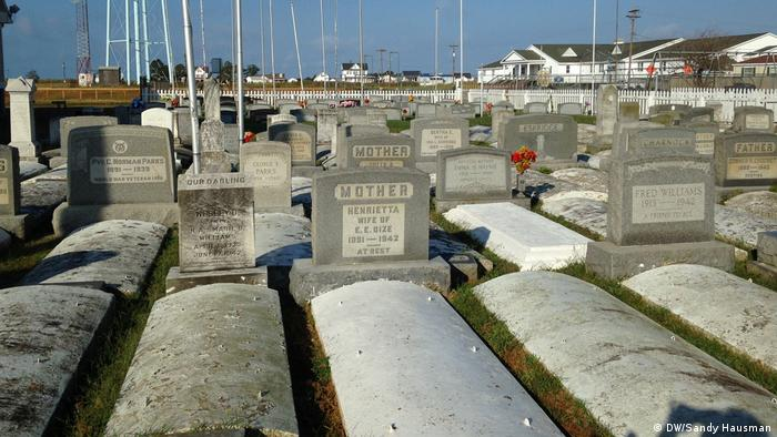 Tombstones and concrete graves that protrude above the ground.