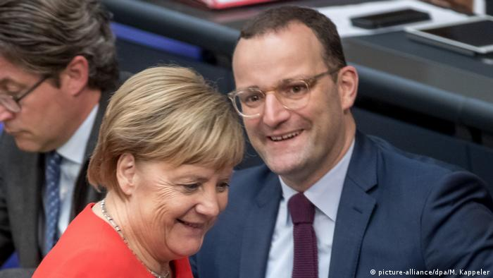Angela Merkel and Jens Spahn