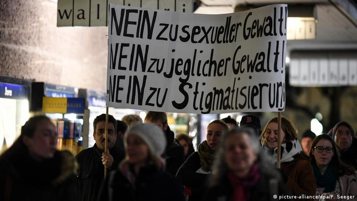 Protesters in Freiburg carrying a placard that reads: No to sexual violence, no to any violence, no to stigmatization