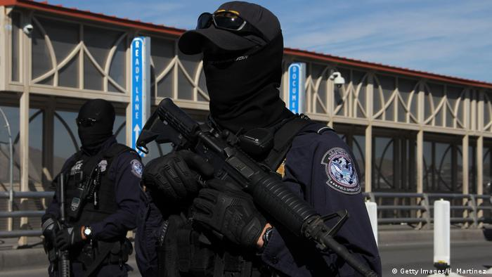US customs and border patrol agents take part in a border security drill at the US-Mexico international bridge