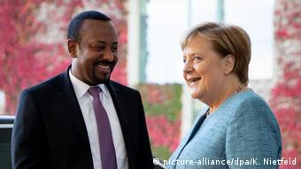 A smiling Abiy Ahmed with Chancellor Angela Merkel