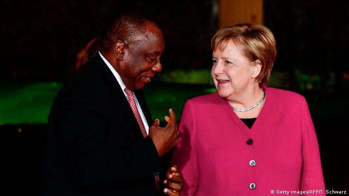 German Chancellor Angela Merkel talks to South African President Cyril Ramaphosa.