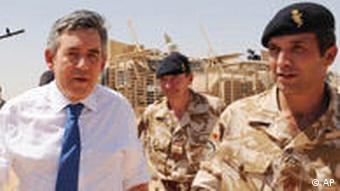 Gordon Brown in Afghanistan walking with an ISAF soldier