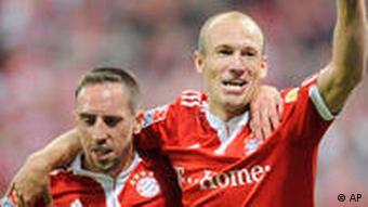 Arjen Robben (d.) i Franck Ribéry