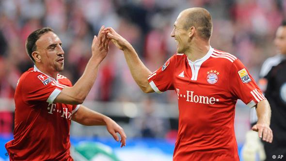 Munich's Arjen Robben, right, celebrates his side's third goal with Franck Ribery
