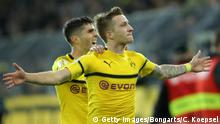 DORTMUND, GERMANY - OCTOBER 31: Marco Reus of Borussia Dortmund celebrates with teammate Christian Pulisic after scoring his team's third goal during the DFB Cup match between Borussia Dortmund and 1. FC Union Berlin at Signal Iduna Park on October 31, 2018 in Dortmund, Germany. (Photo by Christof Koepsel/Bongarts/Getty Images)